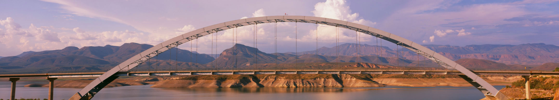 AIF Global arc bridge with mountains in background