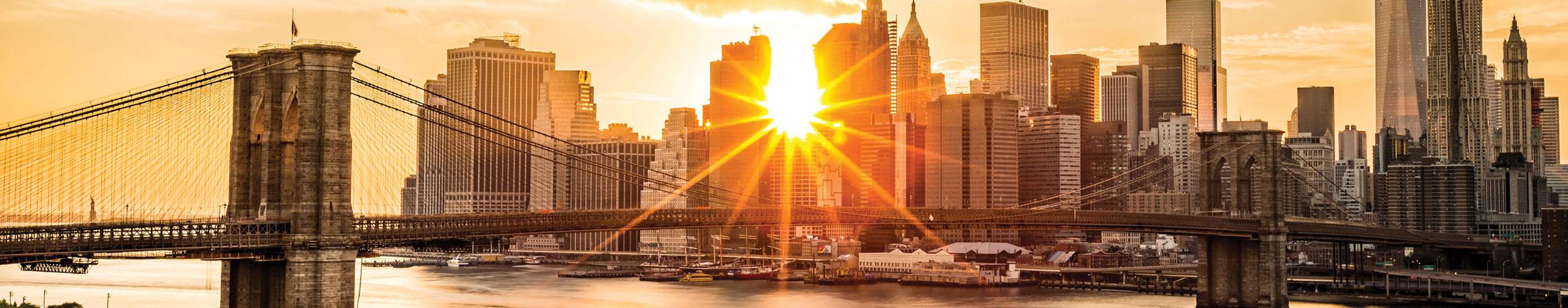 bridge leading into New York City at sunrise